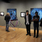 Students discussing art at the ?Senior Art Exhibition? in Everett Gallery.