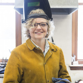 Sculpture professor Stacy Lotz in protective gear, ready to teach welding.