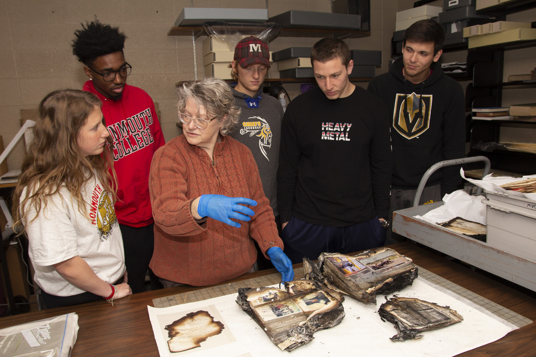Monmouth College technical services librarian Lynn Daw discusses treatments for fire-damaged docu...