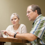 In this file photo, Craig Vivian is shown working with Katie Walker ?18 on her Peace Corps applic...