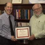 Frank Gersich (right) receives the Hatch Award for Excellence in Service from Dean David Timmerman.