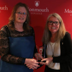 Kim Carrier (left) receives the College?s inaugural Difference Maker Award from Dean of Students ...