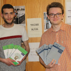 Seniors Amjad Karkout (left) and Isaac Willis hold the two editions of MJUR that were published d...