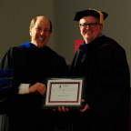 Associate Professor Daniel Ott, right, receives the Hatch Award for Distinguished Scholarship fro...