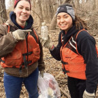 Lily Lindner ?20 (right) shows off the message in a bottle she found while helping clean up trash...