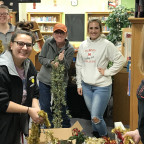 Vice President for Student Life Laura Hutchinson (center, in hat) and more than two dozen Monmout...