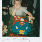 Goble at age 5 with his Superman birthday cake.