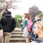 A group of students walk steps near Wallace Hall at Monmouth College. The college is continuing i...
