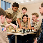 Professor Craig Vivian and a group of scouts are engrossed in a match as part of the Chess merit ...