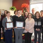 Members of Monmouth College?s development team who posed with the two CASE award plaques are from...