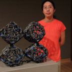 Visiting Assistant Professor Eliza Au stands near a piece from ?Method & Memory,? the current...