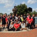 A few of the 337 new students for the fall semester pause for a group picture with library staff ...