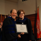 Monmouth College professor Hannah Schell is congratulated by Dean David Timmerman for receiving t...