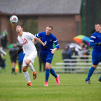 Max Daniels ?16 goes up to head an oncoming soccer ball in a game against Illinois College.