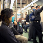 Mexican subway passengers protect against influenza A by wearing medical masks. (photo by Eneas D...