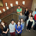 Students from Brianne Donaldson?s Introduction to Liberal Arts class stand with her by their exhi...