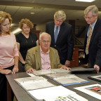 Lew Gould (seated) shares a portion of his First Ladies collection with Monmouth College faculty ...