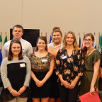 The eight MC students who presented at the ILLOWA conference include, in front, from left, Briann...
