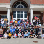 Monmouth College fraternity and sorority members assembled on the steps of the Huff Athletic Cent...