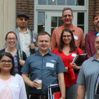 Some of Monmouth College?s new faculty members on the steps of Wallace Hall. Front row, from left...