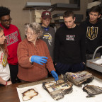 Technical Services Librarian Lynn Daw works with students last semester, shortly after the fire a...