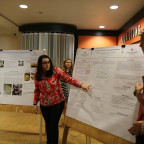 Victoria Burgo ?21 of Chicago makes a point during the SOFIA poster presentations Aug. 18 in the ...