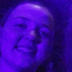 Amanda Green ?20, left, takes in a performance by Blue Man Group during her time at the eight-wee...