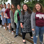 The Monmouth College group straddles the Greenwich Meridian, standing with one foot in each of th...