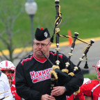 The Monmouth College Pipe Band leads the Fighting Scots football team onto Bobby Woll Field at Ap...