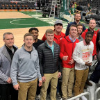 Coach Todd Skrivseth, left, and his men?s basketball team are pictured at Fiserv Forum, home of t...