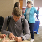 A Monmouth student registers to vote during a campus event run by the American Association of Uni...