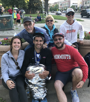 IRONMAN: After completing his first Ironman, Jon Welty is surrounded by family and friends. Clock...