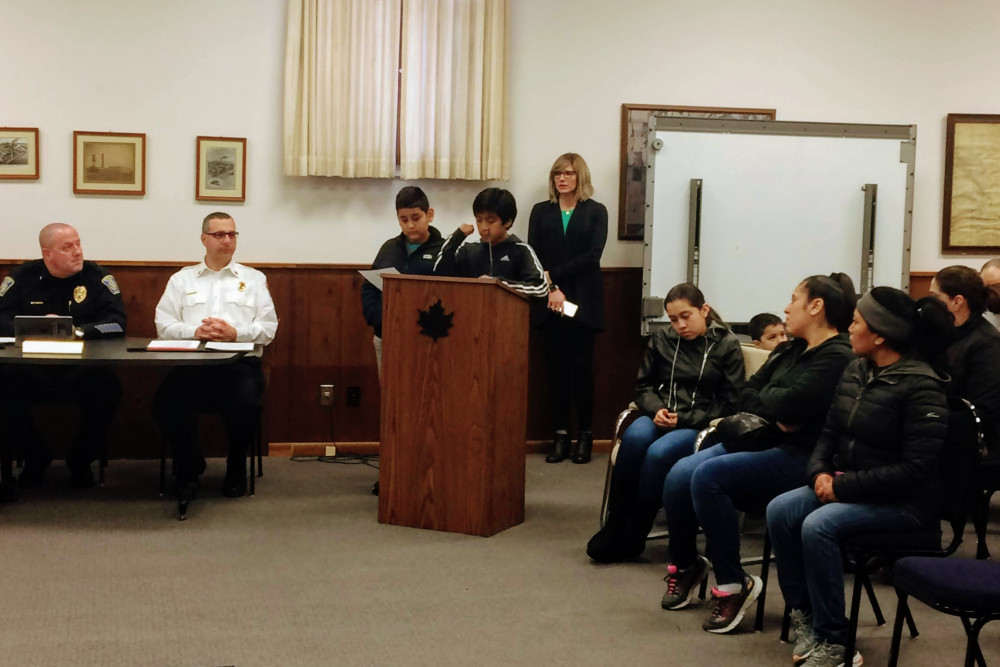 Local sixth-grade students present their proposals at a city council meeting.