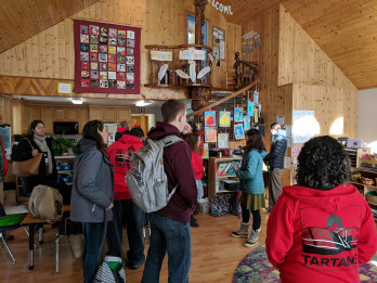 Students and faculty join PLACE Teaching Sites teachers in visiting another school in the nationa...