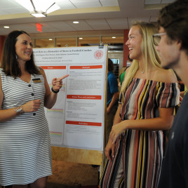 Students in Jen Braun?s SOFIA project display and explain their research on stress and coach?s bo...