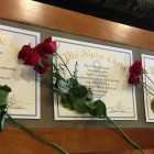 Certificates and flowers for new Phi Alpha Theta initiates