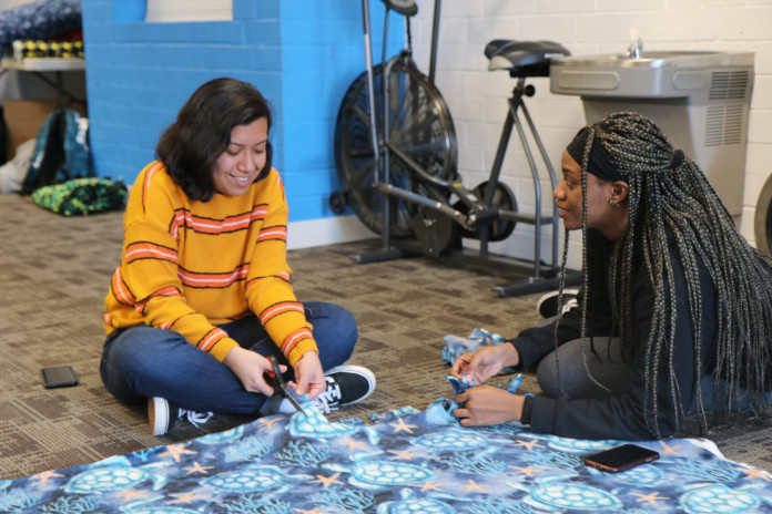 Students make blankets as part of our annual Martin Luther King Jr. Day of Service.