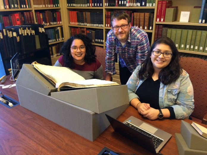 Professor Ermine Algaier, center, leading one of two research trips to Houghton Library at Harvar...