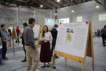 Beatrix Thornton '19 presents her research at Scholars Day.