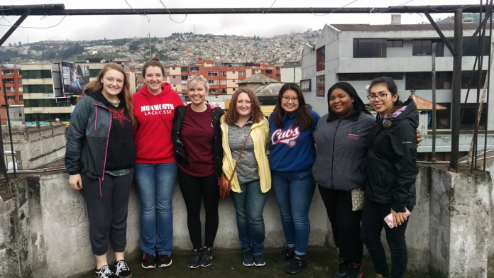 Monmouth students on the terrace of their homestay in Ecuador where they worked with UBECI Volunt...