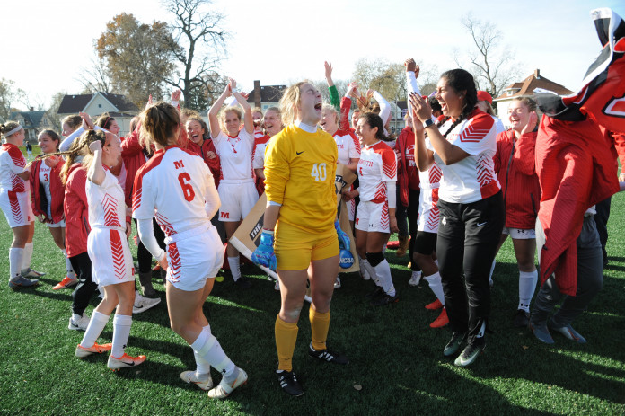 Members of the Fighting Scots women's soccer team members celebrate moments after winning the...