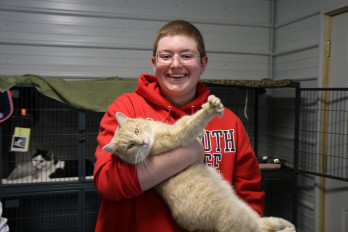 Monmouth students volunteer at the local animal shelter.